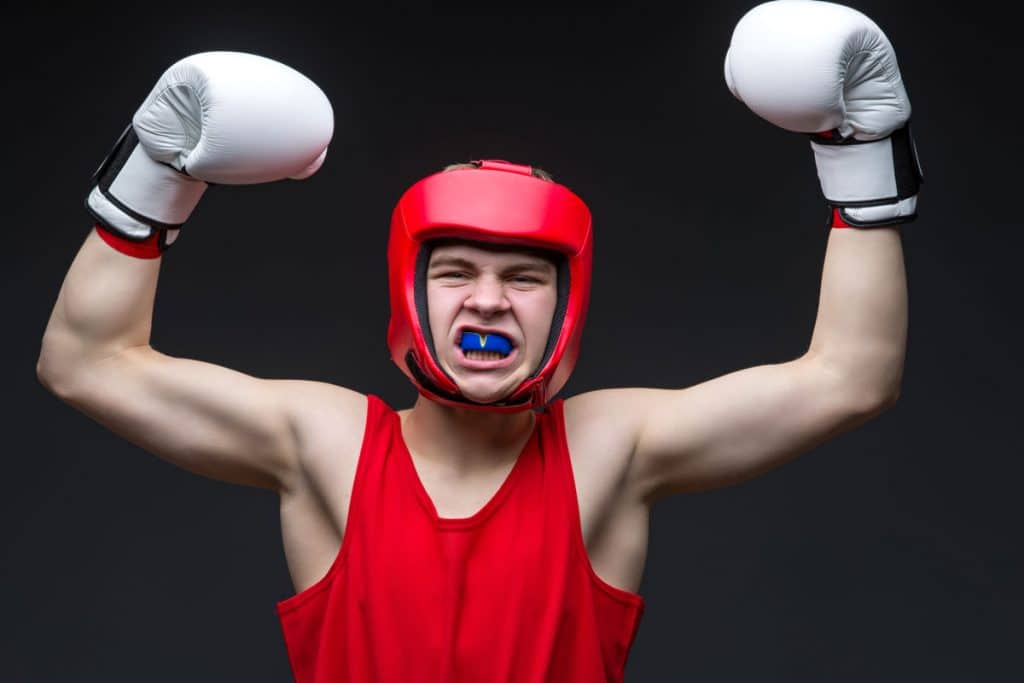 Young boxer with mouthguard